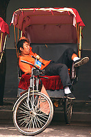 Beijing Rickshaw Nap - Rickshaws were first used in China during the late 1800s and an important element in urban development in 20th century China in terms of  transport and for the employment it provided.  At one time rickshaw men and their dependents made up almost 20 percent of Beijing's population. Many rickshaws disappeared after the founding of the People's Republic of China in 1949 though in recent years they have made a comeback in popular tourist areas of Beijing.