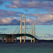 &quot;Mackinac Beauty&quot;<br /> <br /> Enjoy this lovely view of the historic Mackinac Bridge. A wonderful suspension bridge that links lower Michigan to its Upper Peninsula. Deep blue, and green waters in the Mackinac straights as well as gorgeous puffy purple and white clouds complete this beautiful sight!!<br /> <br /> Mackinac Bridge by Rachel Cohen