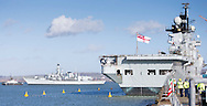 The Type 23 frigate HMS Richmond passes HMS Illustrious as she returns to Portsmouth Royal Navy Base following a seven-month deployment to the South Atlantic. Picture date: Friday 21st February, 2014. Photo credit should read: Christopher Ison. Contact chrisison@mac.com 07544044177