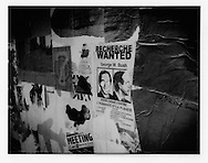8..Defaced anti-Bush poster accuses him of crimes against humanity and the planet, Belleville.