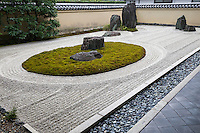 """Ryogintei at Ryogen-in is a very unique moss garden within a Zen garden. The moss shows the waters and the stone projectied from the center symbolises """"Shumisen"""" -  core of the Universe. In Buddhism this Universe is thought to consist of eight seas and nine mountains."""