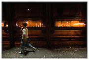 A boy is lighting a candle in the holy sepulchre church, the place where Jesus is supposed to have been burried. Jerusalem, Israel, 2007