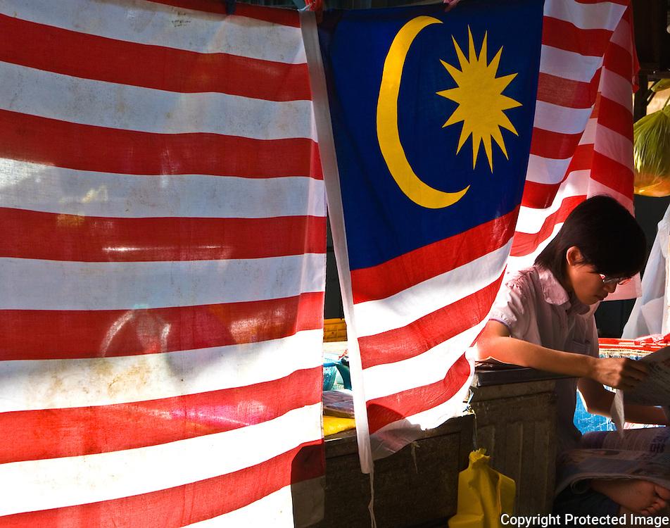 Vendor under Malaysian flag, Imbi market, Kuala Lumpur, Malaysia