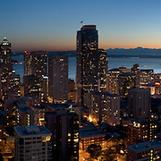 "Downtown Seattle, the Space Needle, Puget Sound and the Olympic Mountains at sunset, on July 4, 2007. Panorama stitched from 4 images photographed by Tom Dempsey from the 33rd floor of First Hill Plaza, 1301 Spring Street, Seattle, Washington. Published in ""Light Travel: Photography on the Go"" book by Tom Dempsey 2009, 2010."