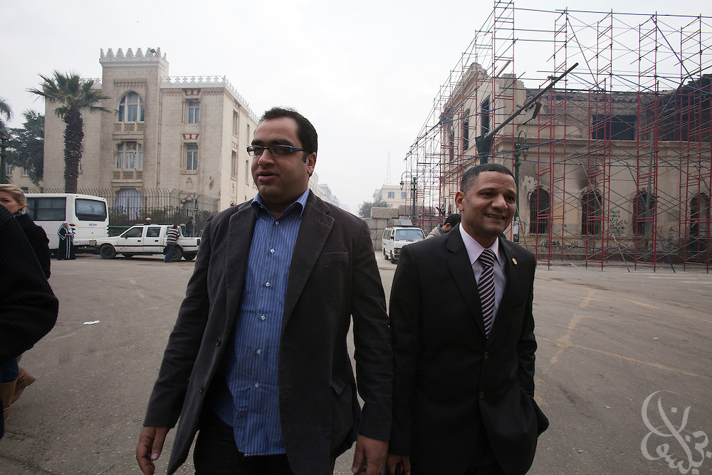 Egyptian Parliamentarian-elect Zyad Elelaimy (l) and fellow Social democratic parliamentarian Khalid Shabani (r) walk towards the parliament complex on his way to the historic first session of Egypt's newly elected Parliament session Jan 23, 2012 in Cairo, Egypt.