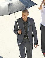 "Los Angeles, CA. December 13th 2010  Non Exclusive. Justin Timberlake returns to work filming his movie ""NOW"" after the production shut down due to an ankle injury Timberlake suffered on set last week. Actress Amanda Seyfried was also on set with Justin and the pair appeared to have great chemistry together on and off camera. After a scene with a gun was finished Amanda jokingly took the gun from Justin and pointed it at his crotch. Justin seemed bothered by his injury at one point when he was seen removing  his shoe and sock to re wrap support on his ankle. Photo by Eric Ford 818-613-3955 onlocationnews@att.net"