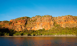 Red cliffs  and mangroves line the banks of the Hunter River on the Kimberley coast.