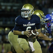 Salesianum quarter back Garrett Cannon (6) attempts hands off the ball in the second quarter Friday, Oct. 09, 2015 at Bernard Stadium in Wilmington, DE.