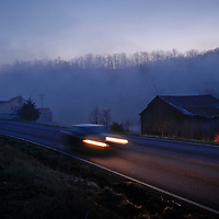 A car sped along KY 11 in the pre-dawn fog in Wild Cat, Ky., on 3/19/10. Photos by David Stephenson