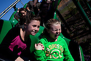 Jillian Brodie, 9, with her sister Emma Brodie, 11, right, from Ontario, Canada, ride on The Dragon roller coaster in Legoland in Whitehaven, Florida on February 11, 2012.