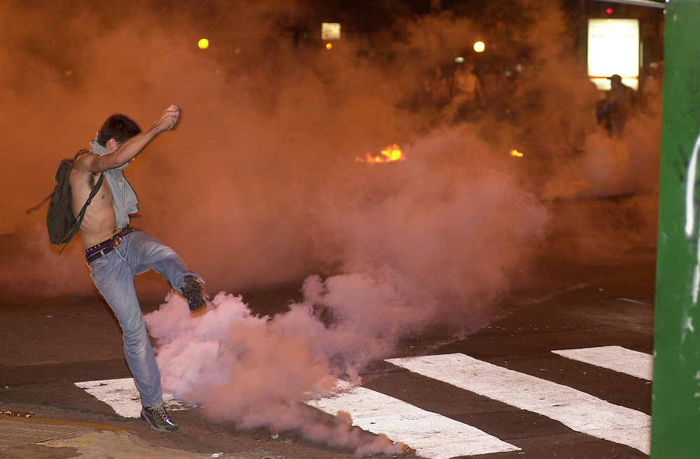 Police fire tear gas during a riot in Buenos Aires - protestors clash with police and destroy banks. .by Neville Elder 02/10/01