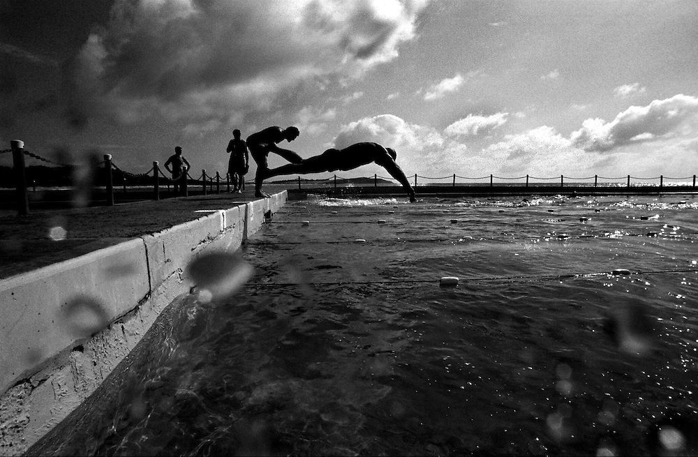 Old man diving with the Icepicks swimmers in Dee Why outdoor pool. @ Martine Perret