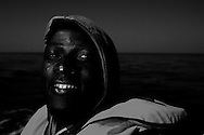 Italy, Southern Mediterranean sea: An African migrant is seen on the boat with whom MSF staff rescued him from the rubber boat with which he left Libya on August 29, 2015. Alessio Romenzi