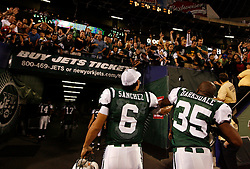 Sept 3, 2009; East Rutherford, NJ, USA;  New York Jets quarterback Mark Sanchez (6) throws his wristbands to fans after his game at Giants Stadium.  The Jets defeated the Eagles 38-27.