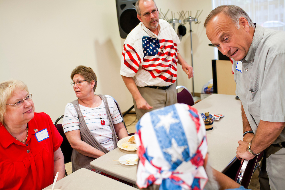 Rep. Steve King (R-IA), right, talks with attendees at a Calhoun County Republican Party dinner before a campaign appearance by Republican presidential candidate Rep. Michele Bachmann (R-MN) on Monday, August 8, 2011 in Rockwell City, IA.