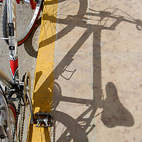 Bycicle and its shadow in Formentera, Balearic Islands, Spain