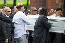 © Licensed to London News Pictures. 21/04/2017. Leeds UK. Leeds United footballer Malik Wilks (white shirt ) acting as a Pallbearer at the funeral of his brother Raheem Wilks. The funeral of Raheem Wilks is taking place today at St Aidan's church in Leeds. Raheem who is the brother of Leeds United footballer Malik Wilks died as a result of a single gunshot wound to the chest outside a barber shop on Gathorn Terrace in the Harehills area of Leeds in January. Photo credit: Andrew McCaren/LNP