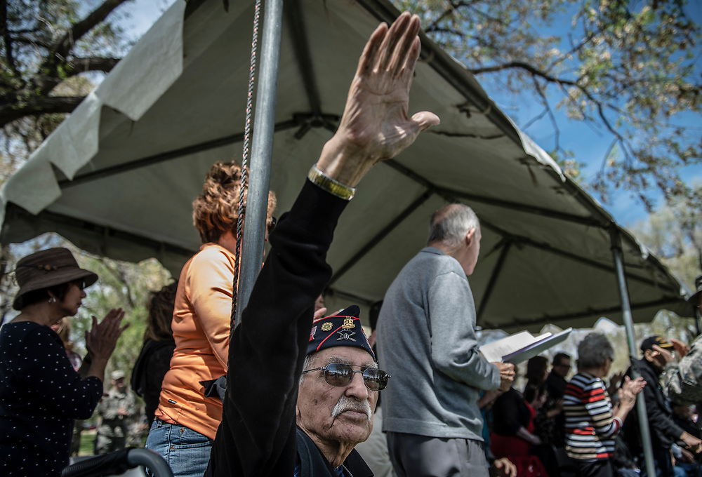 rer040817c/A1/04.08.2017/Roberto E. Rosales <br /> Bataan survivor Joe Romero(Cq) of Bernalillo, New Mexico waves to the crowd as he is acknowledged. On Saturday the 75th Anniversary surrender of Bataan ceremony took place at Bataan Memorial Park. <br /> Albuquerque, New Mexico(Roberto E. Rosales/Albuquerque Journal)