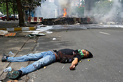 A young man lies dead within the Red-shirt camp, killled during military crackdown to end the Red-shirt protests.
