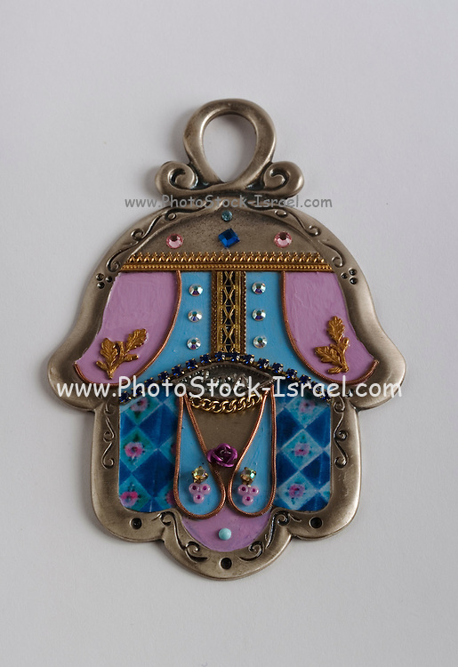 Studio shot of a decorated silver Hamsa