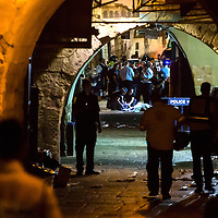 Israeli security forces, emergency services and forensics gather next to the body of a Palestinian who carried out a stabbing attack in the old city of Jerusalem on October 3, 2015. Photo by Olivier Fitoussi.