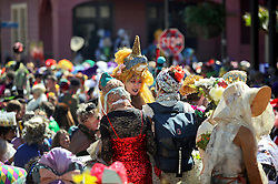 09 February 2016. New Orleans, Louisiana.<br /> Mardi Gras Day. Revelers in bright and coolurful costumes fill the French Quarter. <br /> Photo&copy;; Charlie Varley/varleypix.com