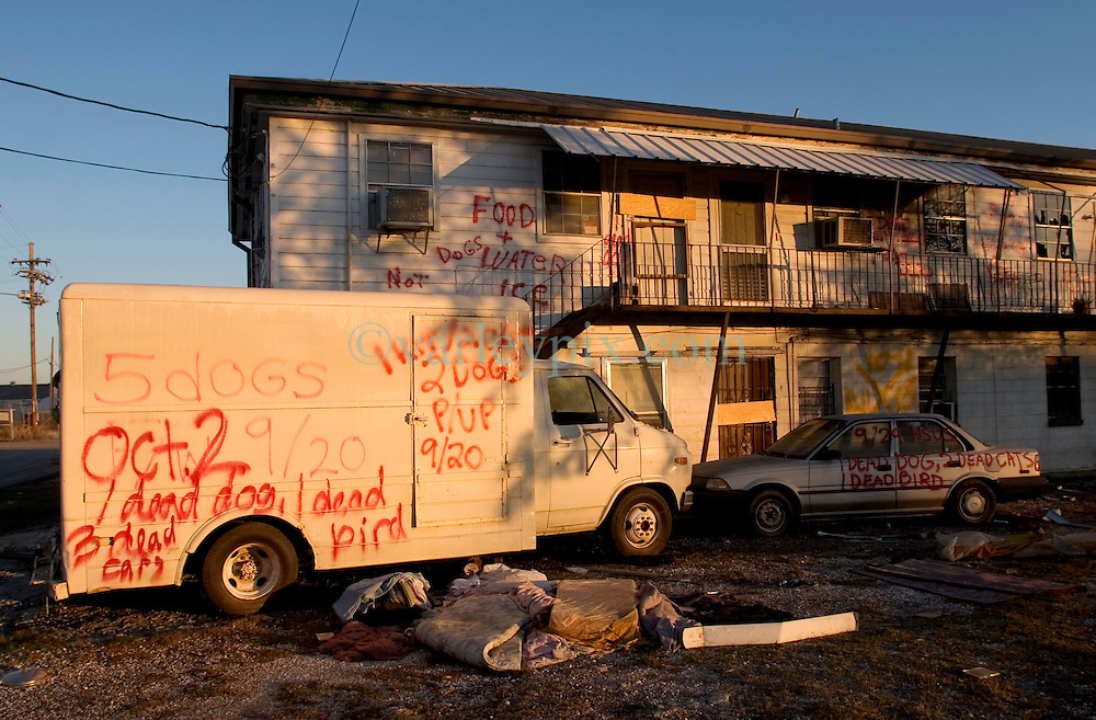 21 December 05. New Orleans, Louisiana. Post Katrina aftermath.<br /> Rescue workers graffiti lingers on trucks, cars and walls of the devastated 9th Ward long after the devastating flood from Hurricane Katrina subsided. <br /> Photo; &copy;Charlie Varley/varleypix.com