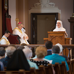 Lisa Johnston | lisajohnston@archstl.org | @aeternusphoto  Sister Joseph Maureen Hobin read the reading in French during a Mass celebrating the 250th anniversary of the founding of St. Louis.  The Mass was held for religious of the Archdiocese at the Basilica of Saint Louis, King of France on Sunday, Aug. 24.  In attendance was His Eminence Cardinal Justsin Rigali , Papal Legat and Archbishop-emeritus of Philadelphia, Archbishop of St. Louis Robert J. Carlson and Bishop Edward Rice of St. Louis.   Special guests in attendance at the Mass were Prince Louis de Bourbon and his wife Princess Marie-Marguerite.  Prince Bourbon is the eldest of the Capetians and the legitimate successor of the kings of France.
