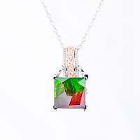 Product photography of jewelry made with ammolite precious gems for Korite International for use on print collateral and digital marketing tools.<br /> <br /> &copy;2016, Sean Phillips<br /> http://www.RiverwoodPhotography.com