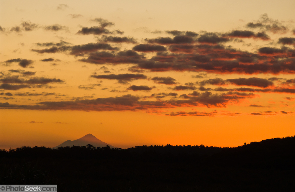 "The volcanic cone of Mount Egmont / Taranaki (2518 meters or 8261 feet) rises in Mount Egmont National Park and glows at sunset, seen from Tongariro in New Zealand, North Island. Taranaki was a stand-in for Mount Fuji in the Tom Cruise motion picture, ""The Last Samurai""."