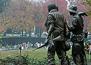 "On the 25th anniversary of the Vietnam Wall November 11, 2007 in Washington DC, the soldiers in the monument ""The Three Soldiers"" look toward the Vietnam Memorial Wall,  the better known part of the Vietnam Memorial..."
