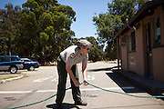 State Park Aide Jennifer Cummesky straightens a hose at Brannan Island State Recreation Area near Rio Vista, Calif., June 13, 2012. Brannan Island is one of ten state parks to be taken over by a private concession in an effort to prevent mass park closures. CREDIT: Max Whittaker/Prime for The Wall Street Journal.CALPARKS.