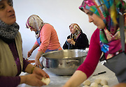Women from Turkish descent celebrate Eid al-Fitr in their mosque in Antwerp and cook Turkish pancakes. Eid al-Fitr is one of the two most important celebrations for Muslims all over the world and celebrated within the family. Antwerp, Belgium, 2012