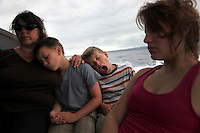 Michele Pascale and her sons Neal and Tim, right, from Grenoble, France, and Daniella Alarcon, right, from Quito, try to sleep on the two-hour boat ride from Santa Cruz to Isabela island in the Galapagos islands of the coast of Ecuador on June 20, 2009. While there are airports on the three main islands of Galapagos, most travel is via boats among the islands.