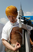 NEW YORK, NY-06 JUL04-- Champion Takeru Kobayashi flexes at the weigh-in the day before the competition. (Extra) The Gazette/Liam Maloney