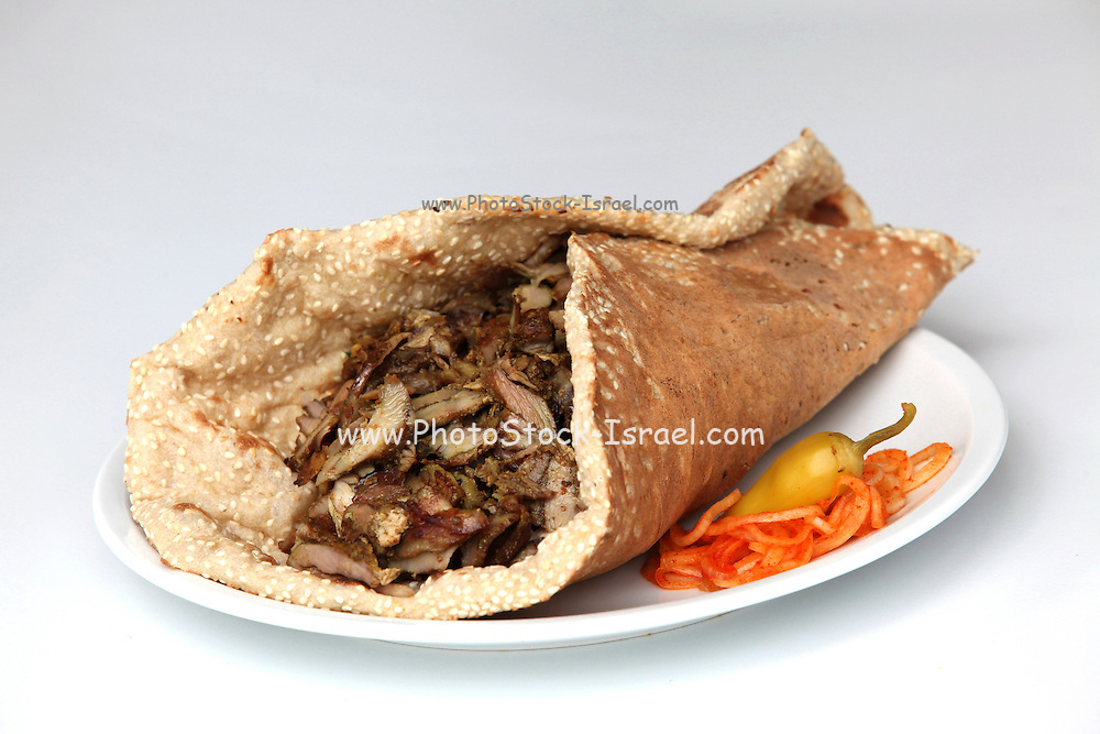 Lamb and turkey shawarma in a Lafa (flat Iraqi pita)