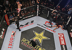 Feb 12, 2011; East Rutherford, NJ; USA; Andrei Arlovski (black trunks) is knocked out by Sergei Kharitonov (red trunks) during the first round of their fight during their opening round bout of the Strikeforce Heavyweight Grand Prix at the IZOD Center in East Rutherford, NJ.