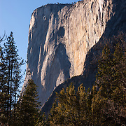 El Capitan, a prominent granite monolith in Yosemite National Park, California, extends about 3,000 feet (900 meters) from the Yosemite Valley floor. The summit of El Capitan is at an elevation of 7,573 feet (2,308 meters).