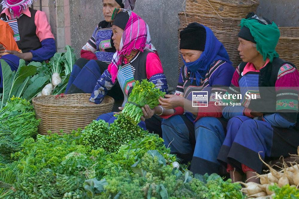 Hani people at local produce market, Yuanyang, Yunnan, China