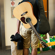A student hauls his most important possessions into Coughlin Hall during New Student Orientation 2012. (Photo by Rajah Bose)
