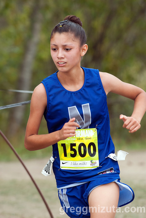 Nyssa freshman Delia Deleon on the final turn to the finish line during the Bob Firman Invitational D2 race at Eagle Island State Park in Eagle, Idaho on September 21, 2013. <br /> Deleon, Nyssa's top finisher, placed seventeenth with a time of 21:15.74.