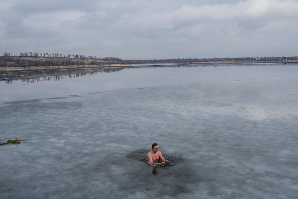 Sergei Korotun partakes in his daily health ritual of bathing in the icy local reservoir on Sunday, February 14, 2016 in Karlivka, Ukraine.