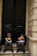 Grabbing a bite to eat in a Galata doorway, Istanbul, Turkey