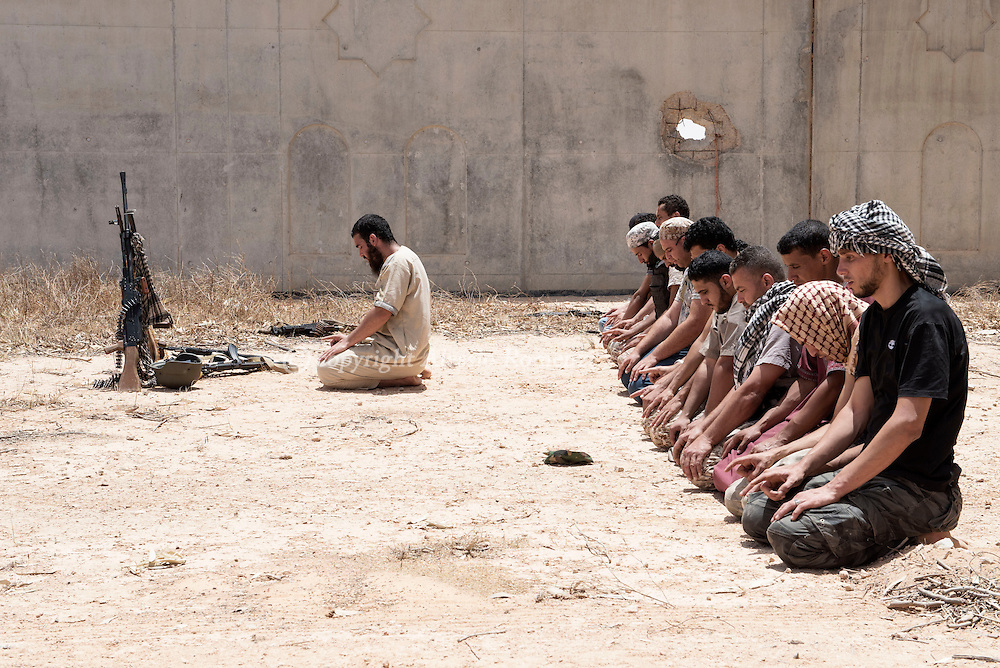 Libya: as clashes with ISIS go on, fighters affiliated with Libya's Government of National Accord's (GNA) pray. Alessio Romenzi
