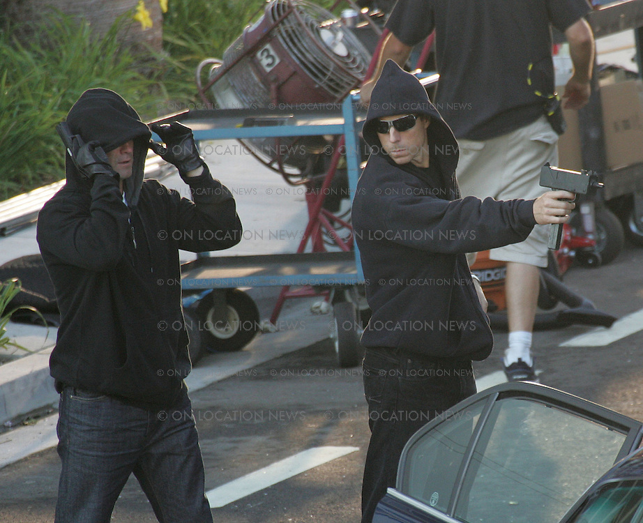 """LOS ANGELES, CALIFORNIA - TUESDAY 15TH JULY 2008 EXCLUSIVE PHOTO Emily Procter, Adam Rodriguez and Rex Linn film scenes for CSI Miami...After a shoot out with the bad guys The CSI's investigate the crime scene. During the filming a green butterfly type bug relentlessly kept flying around actor Adam Rodriguez. After first being irritated by the insect Rodriguez then started to have fun with the bug by dancing and playing with it. After the insect landed on Adam's hand and wrist he walked around the set intoducing his new """"pet"""" to all the crew and joked that he was going to take the bug home and that the bug would be his new CSI partner in the show. Photograph: On Location News. Sales: Eric Ford 1/818-613-3955 info@OnLocationNews.com"""
