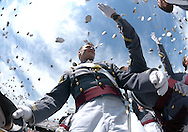 """Newly commissioned 2nd. Lieutenants toss their covers skyward in the traditional """"hat toss"""" during Army's Graduation and Commissioning ceremony in Michie Stadium at the United States Military Academy in West Point, NY on Saturday, May 22, 2011. Navy Admiral Michael Mullen, the Chairman of the Joint Chiefs of Staff delivered the commencement address as 1,031 cadets received their diplomas and were commissioned as 2nd. Lieutenants in the U.S. Army."""