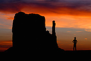 A Cowboy watches the sunset over the Mittens in Monument Valley on the southern border of Utah with northern Arizona. The valley lies within the range of the Navajo Nation Reservation. The Navajo name for the valley is Tsé Bii' Ndzisgaii - Valley of the Rocks.