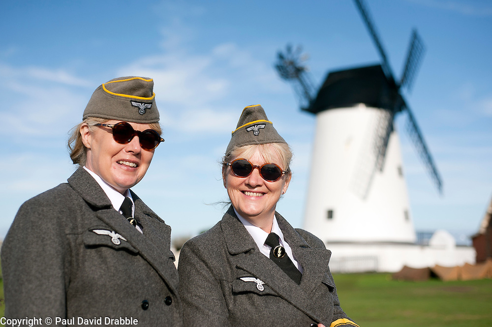 reenactors dressed as German army female signals auxiliaries (Nachrichtenheflrennin des heeres) also nicknamed Blitzm&auml;dchen or lightening girls because of the signals insignia on their uniforms, Pictured beside Lytham Windmill<br /> during the Lytham Saint Annes wartime weekend <br /> Saturday 18th August 2012<br /> Image &copy; Paul David Drabble