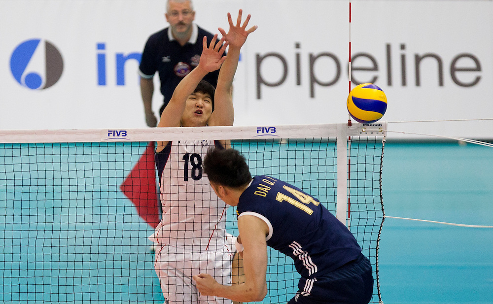 Jiseok Jung (18) of Korea block the spike of China's Qingyao Dai (14)  at a World League Volleyball match at the Sasktel Centre in Saskatoon, Saskatchewan Canada on June 26, 2016.