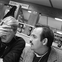 Tim Rasmussen and Rolando Otero, both members of the Black Team, after nearly 48 hours without sleep, grab breakfast at the diner adjacent to the hotel.
